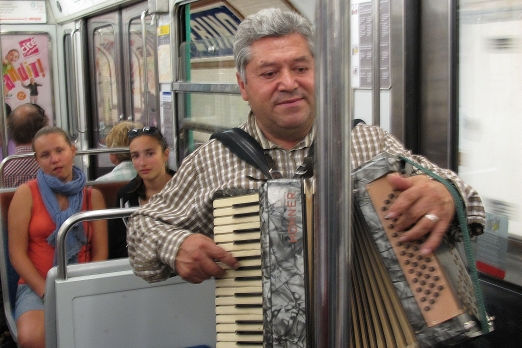 Musician in an underground train - Paris - July 2011