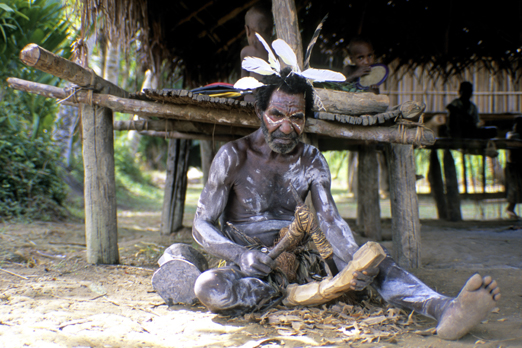 A native man is carving near the Korewori river - East Sepik Province - PNG 2007