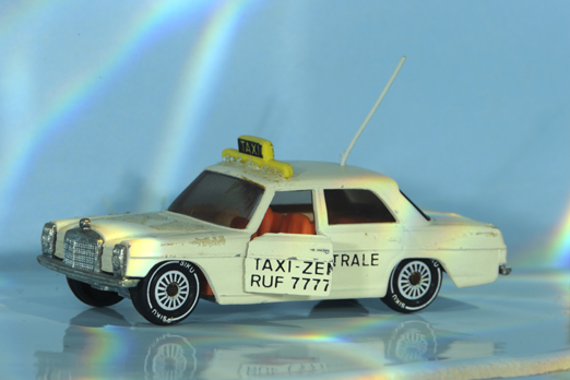 Underwater photo of a small taxi model - Muehltalbad - Darmstadt - Germany - 2009