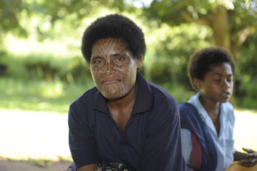 Woman with a traditional face tattoo at Tufi market - Oro Province - PNG 2009