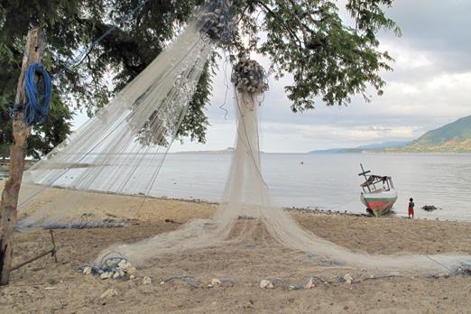 Fishnet drying in a village - Pantar - Alor-Archipelago - Indonesia 2010